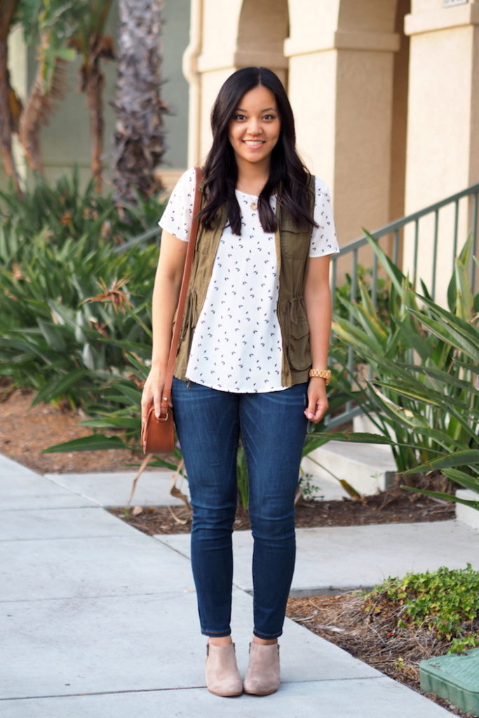 printed top + utility vest + jeans + ankle boots - cute fall outfit