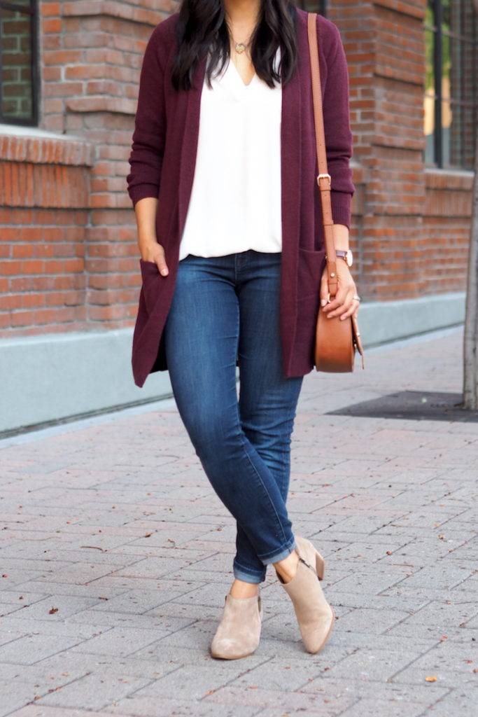 white blouse + maroon cardigan + ankle boots + jeans