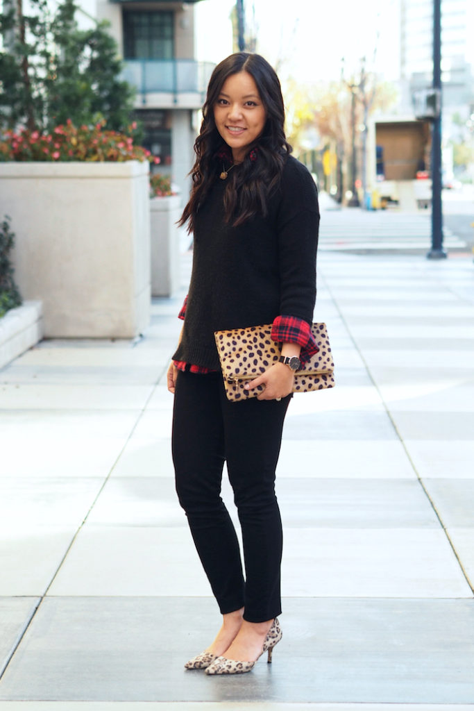 red plaid button up + black sweater + black jeans + leopard print