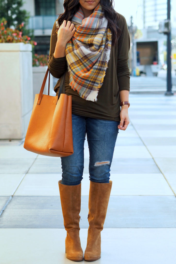 olive top + distressed jeans + tan suede boots + blanket scarf