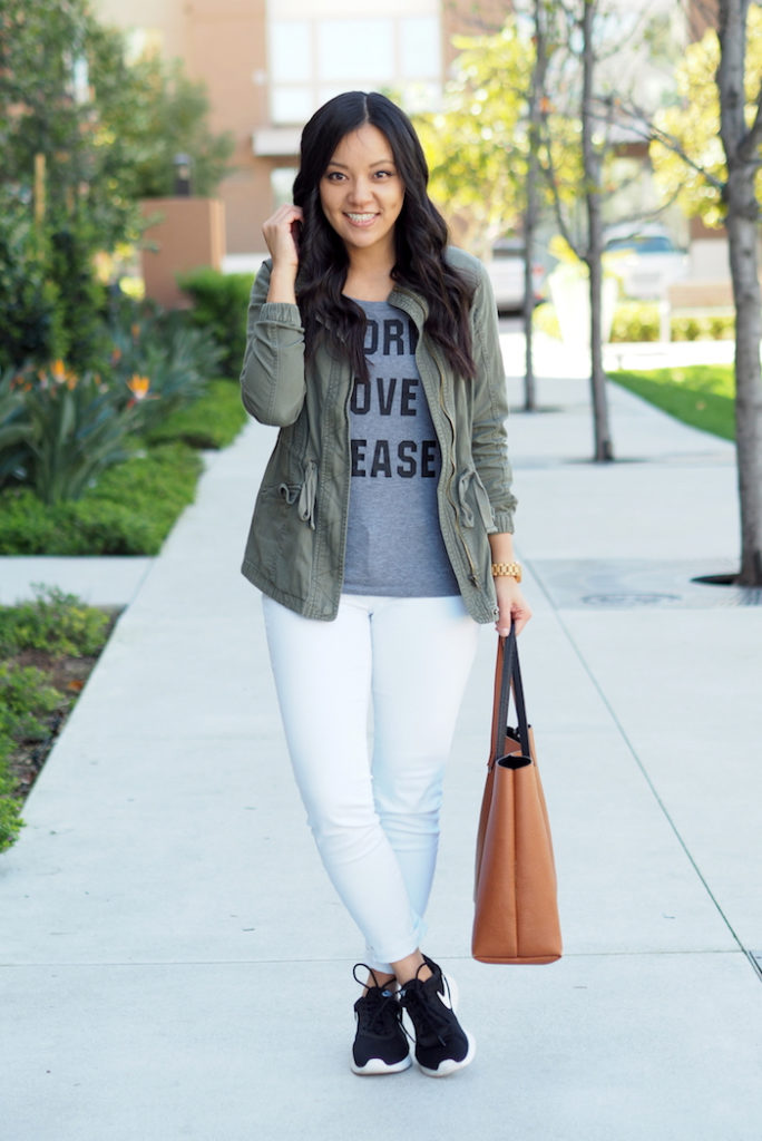white jeans + black Nike Tanjun sneakers + utility jacket
