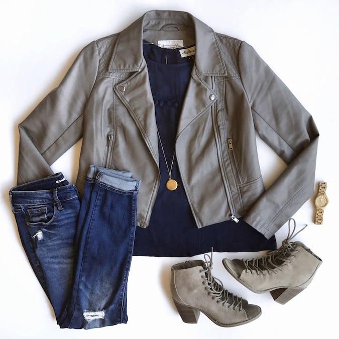 grey leather moto jacket + navy top + jeans + statement heels