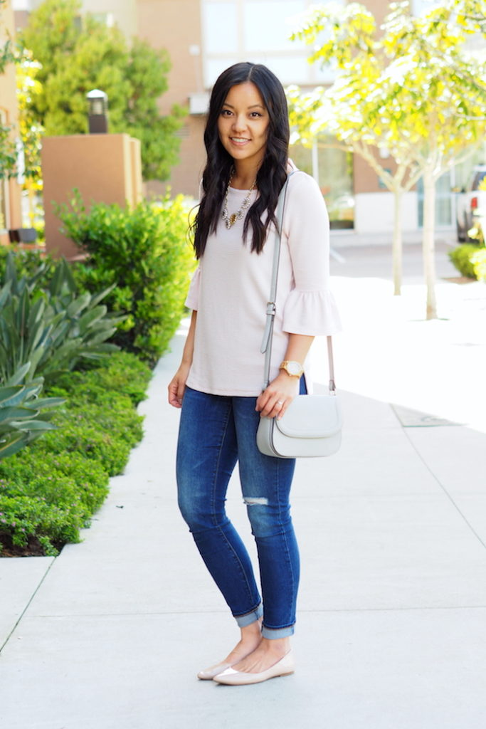 blush top + distressed jeans + nude flats