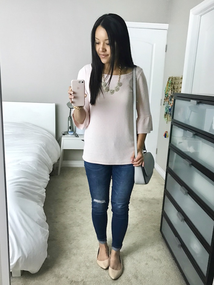 pink bell sleeve top + distressed jeans + nude flats + statement necklace