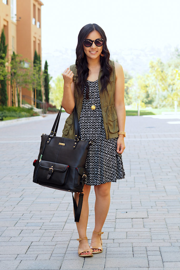black printed dress + utility vest + tan sandals