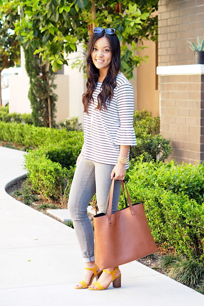 striped bell sleeve top + grey jeans + yellow heels