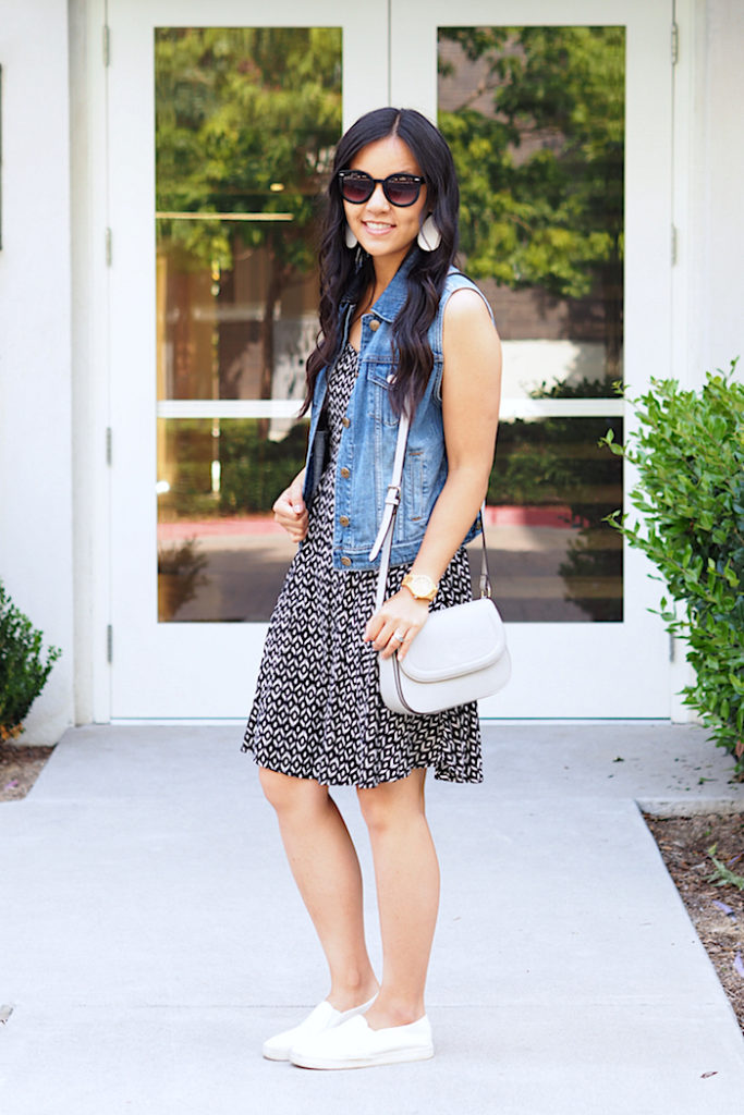 printed dress + denim vest + white sneakers + white earrings