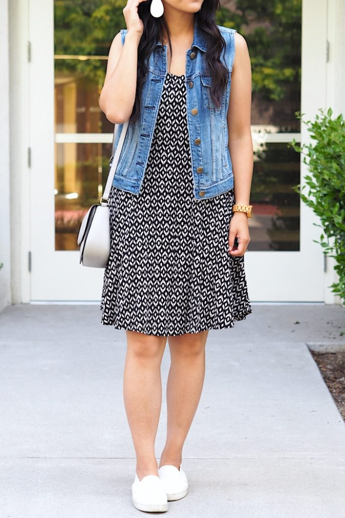 printed dress + denim vest + white sneakers
