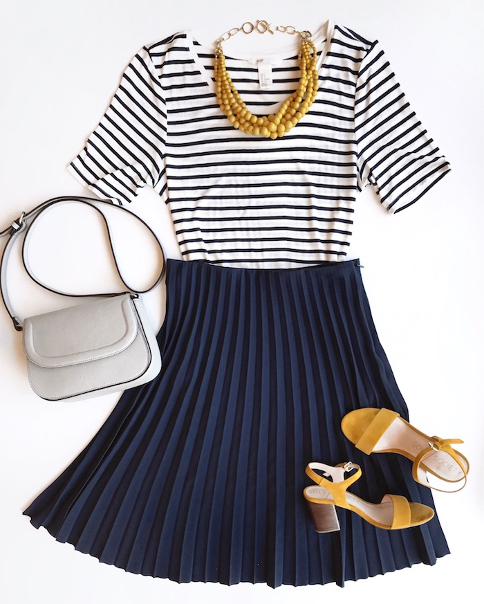 navy pleated skirt + striped tee + yellow accessories