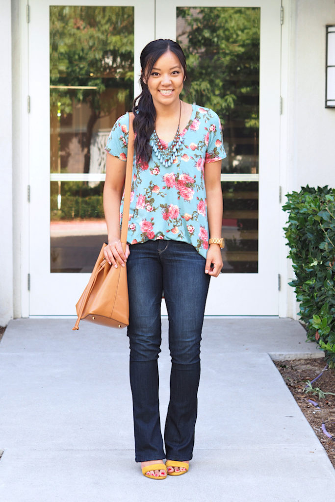 blue floral print top + statement necklace + bootcut jeans + yellow heels