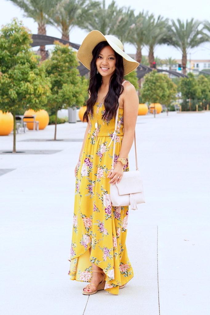 yellow floral print dress + floppy hat + blush bag + wedges