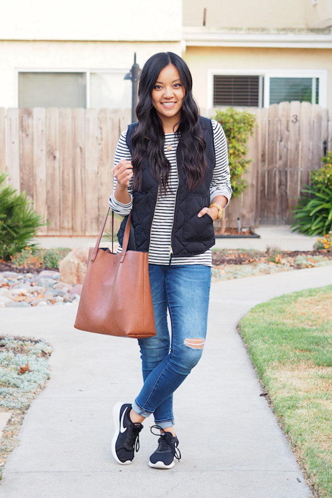 black vest + striped tee + black sneakers