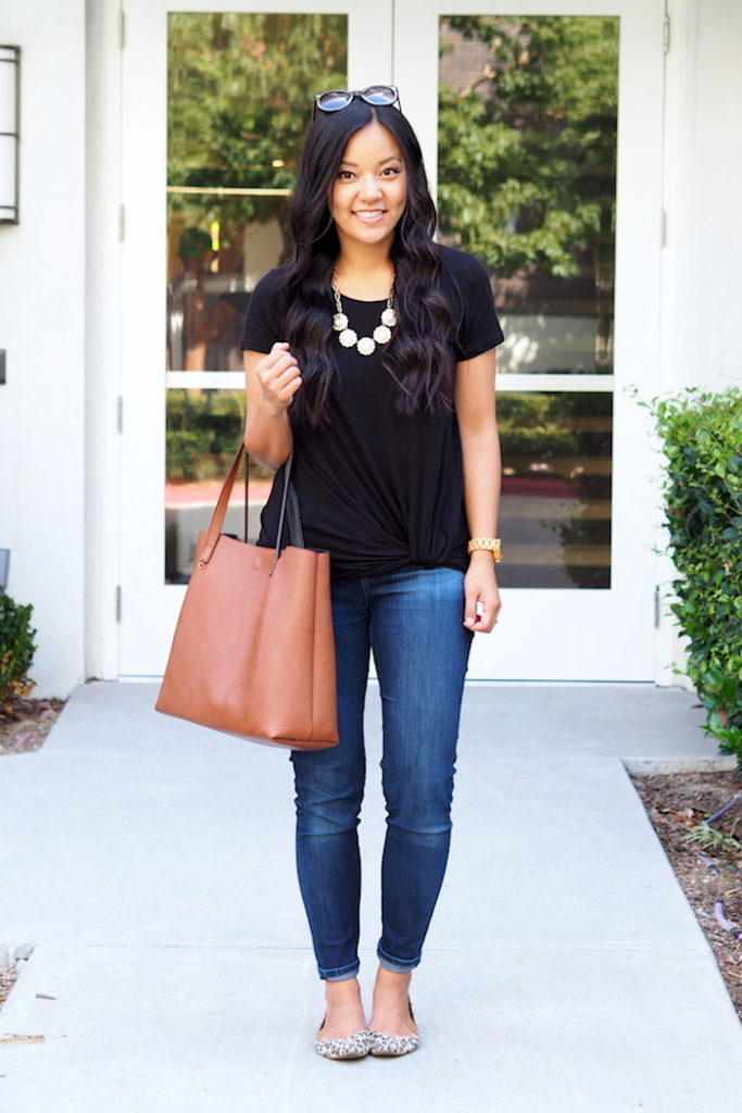 black twist tee + jeans + statement necklace + leopard flats