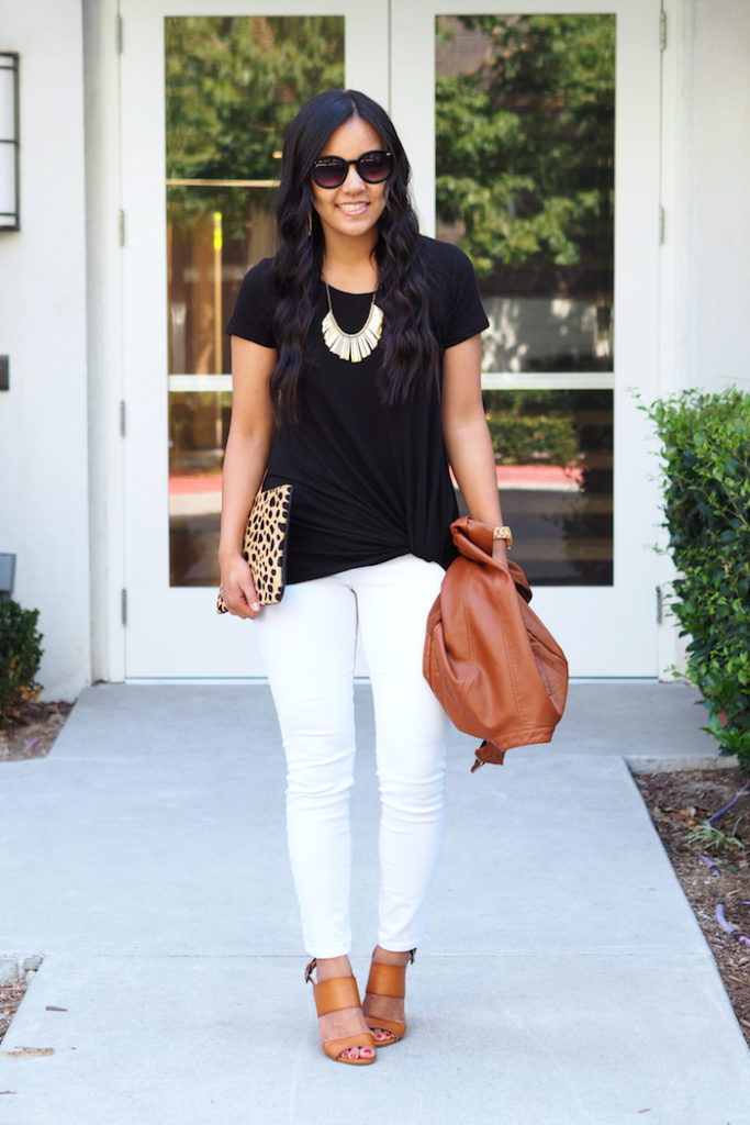 black twist tee + metallic statement necklace + white jeans + tan + pop of leopard