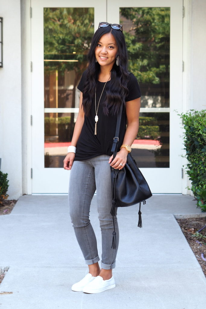 black twist tee + grey jeans + white sneakers + white accessories