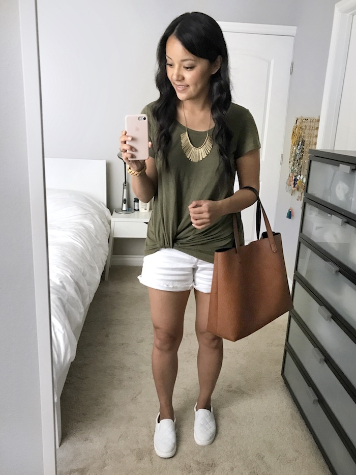 Olive twist tee + white shorts + white shoes + tan handbag
