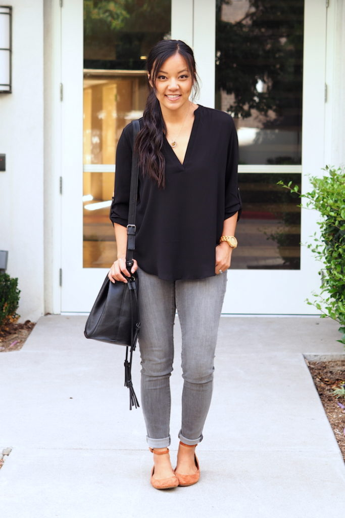 Black blouse + gray jeans + black bag + red flats