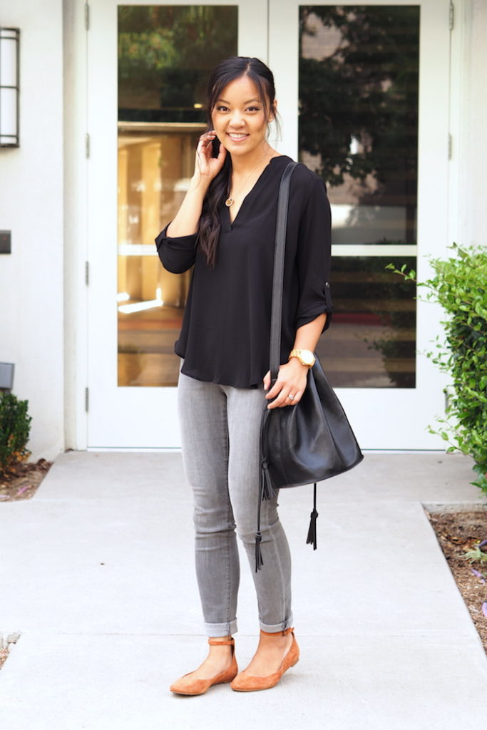 Gray jeans + black blouse + black bag + flats