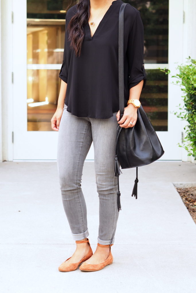 ballet flats + gray jeans + black blouse + black bag