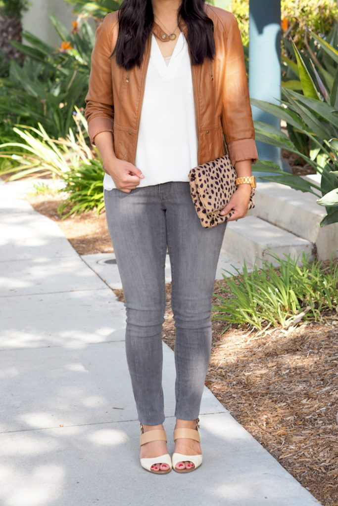 gray jeans + leopard bag + leather jacket + white blouse