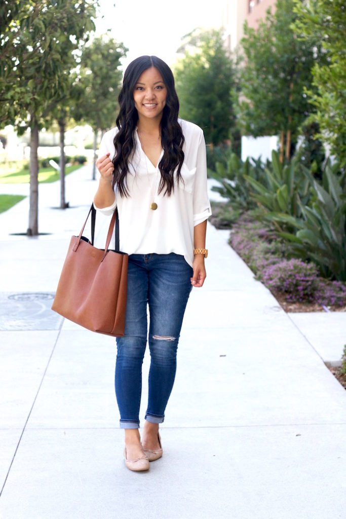 white blouse + distressed jeans + nude flats + large handbag