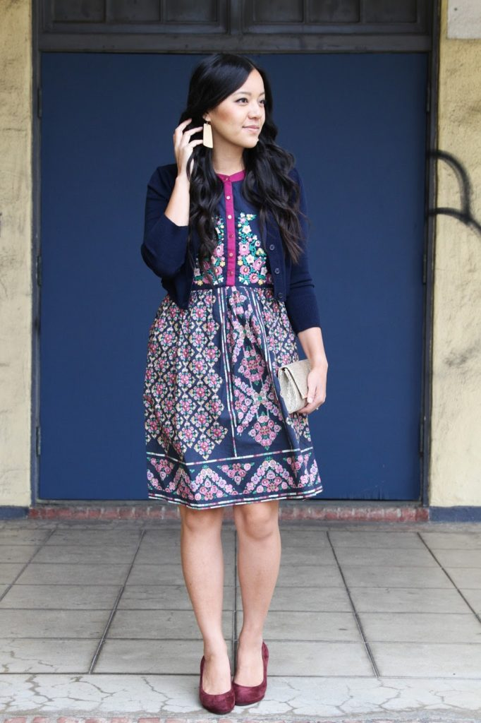 8fb2415653 Navy Cardigan + Navy and Floral Dress + Maroon Pumps + Gold Earrings + Gold  Clutch