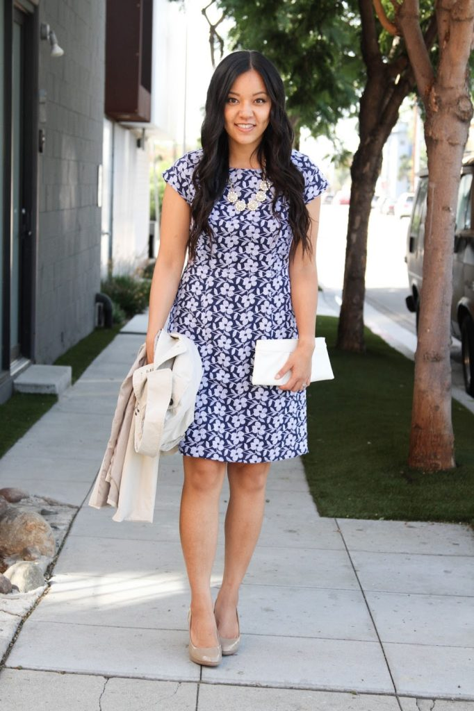 Blue Floral Dress + White Trench Coat + Clutch + Statement Necklace + Nude Pumps