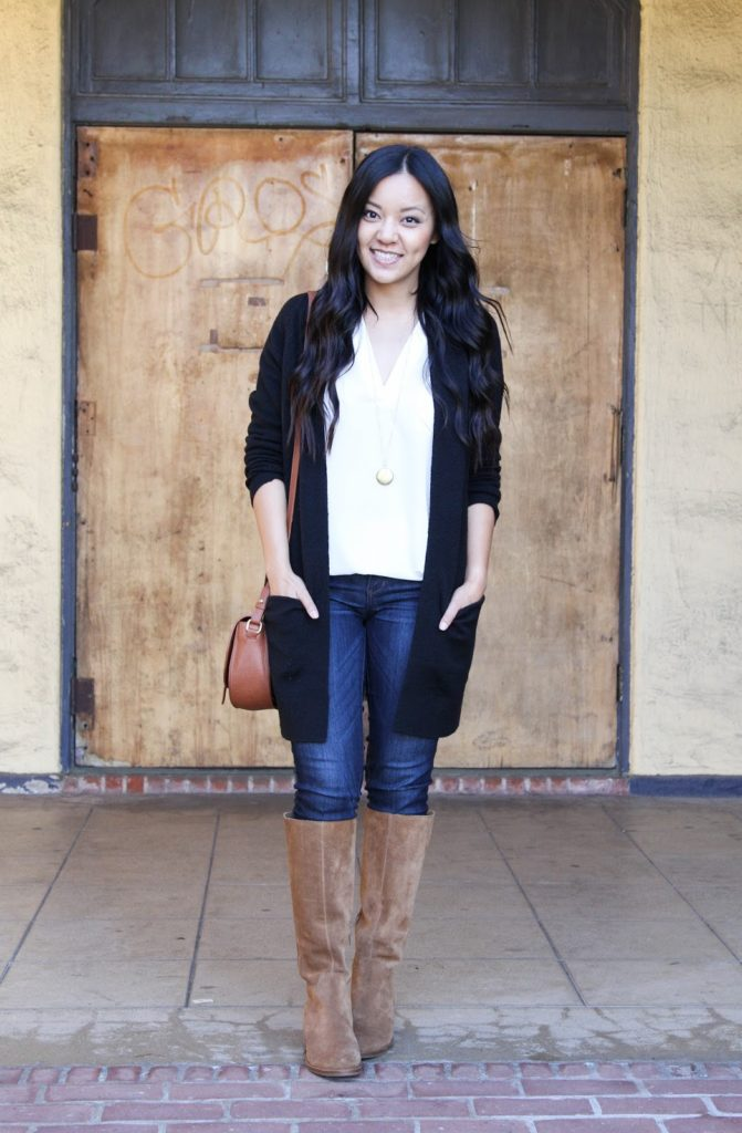 White Tunic + Black Sweater + Riding Boots + Pendant Necklace
