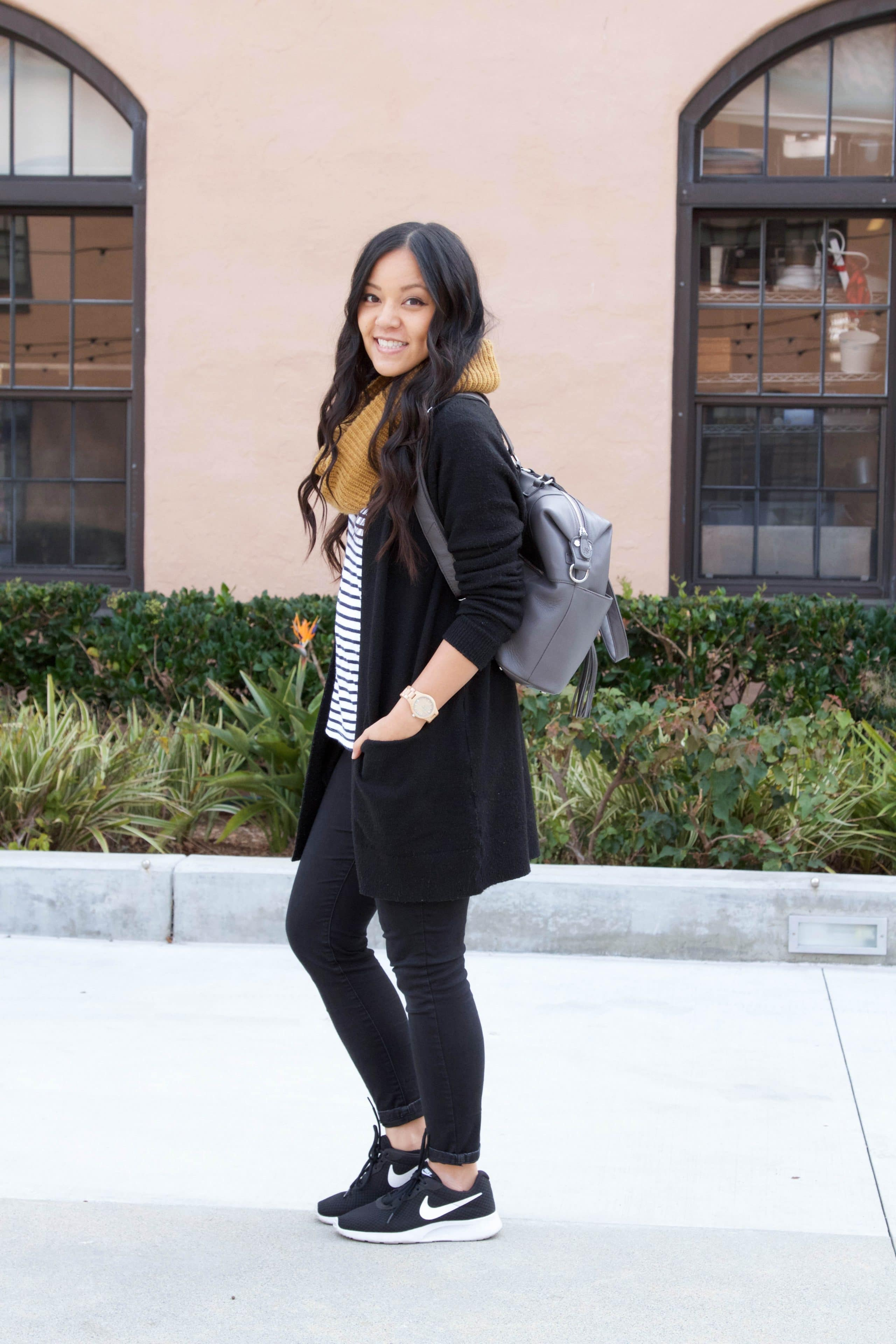 Travel Outfit: Black Skinnies + Sneakers + Scarf + Striped Tee + Gray Bag