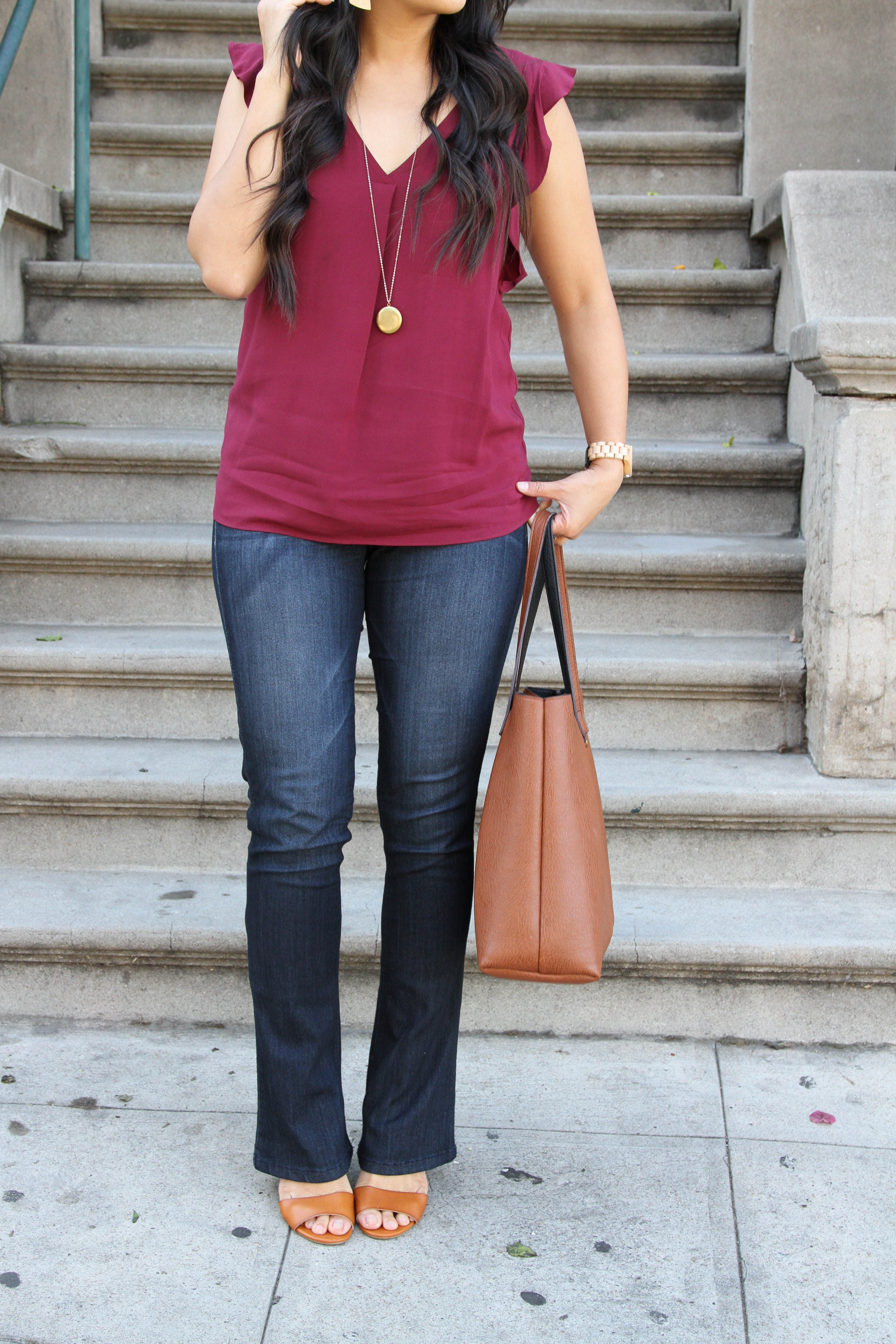 Bootcut jeans + maroon top + cognac bag + cognac shoes