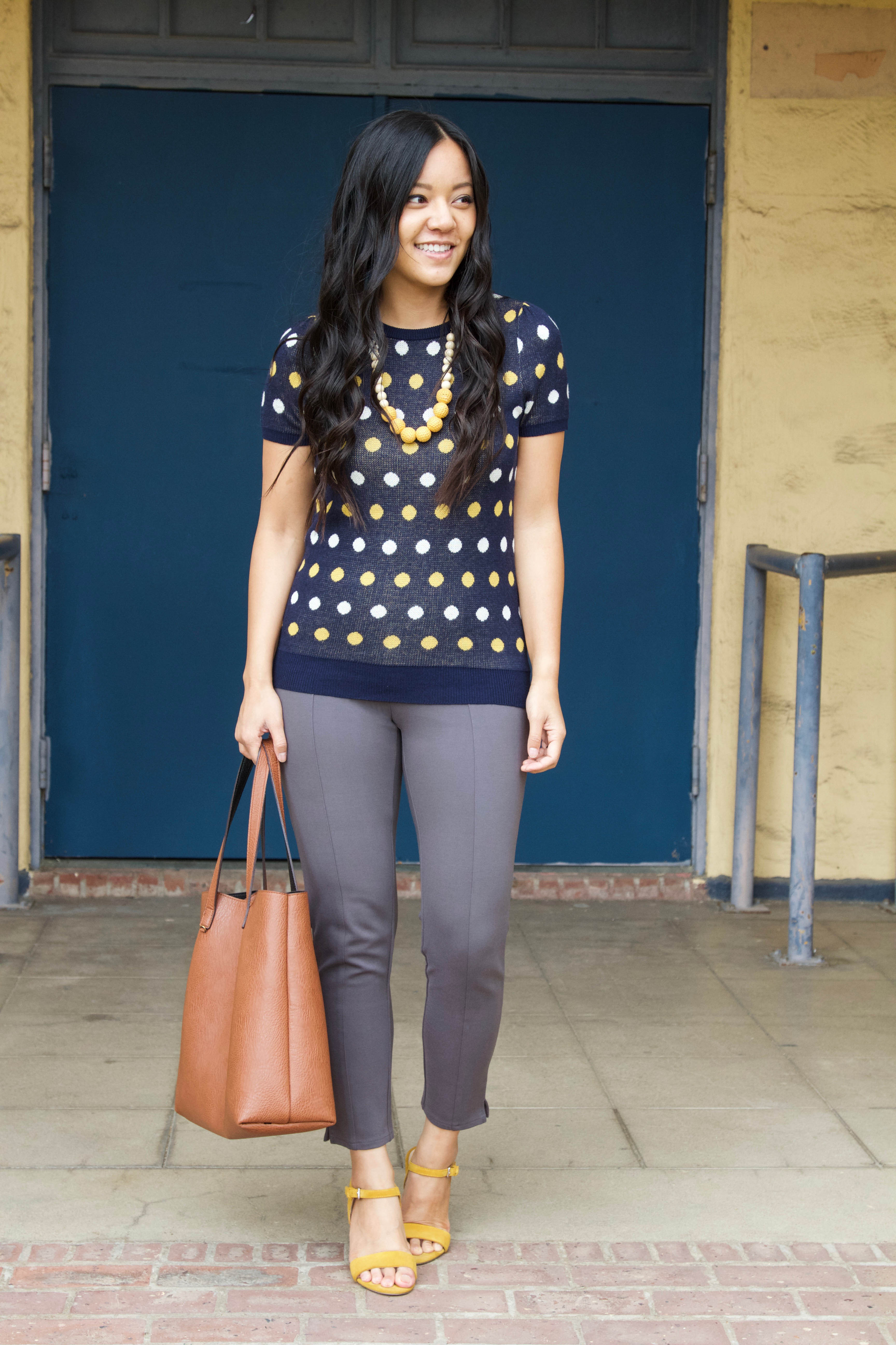 Business Casual Outfit: grey slacks + navy printed polka dot sweater