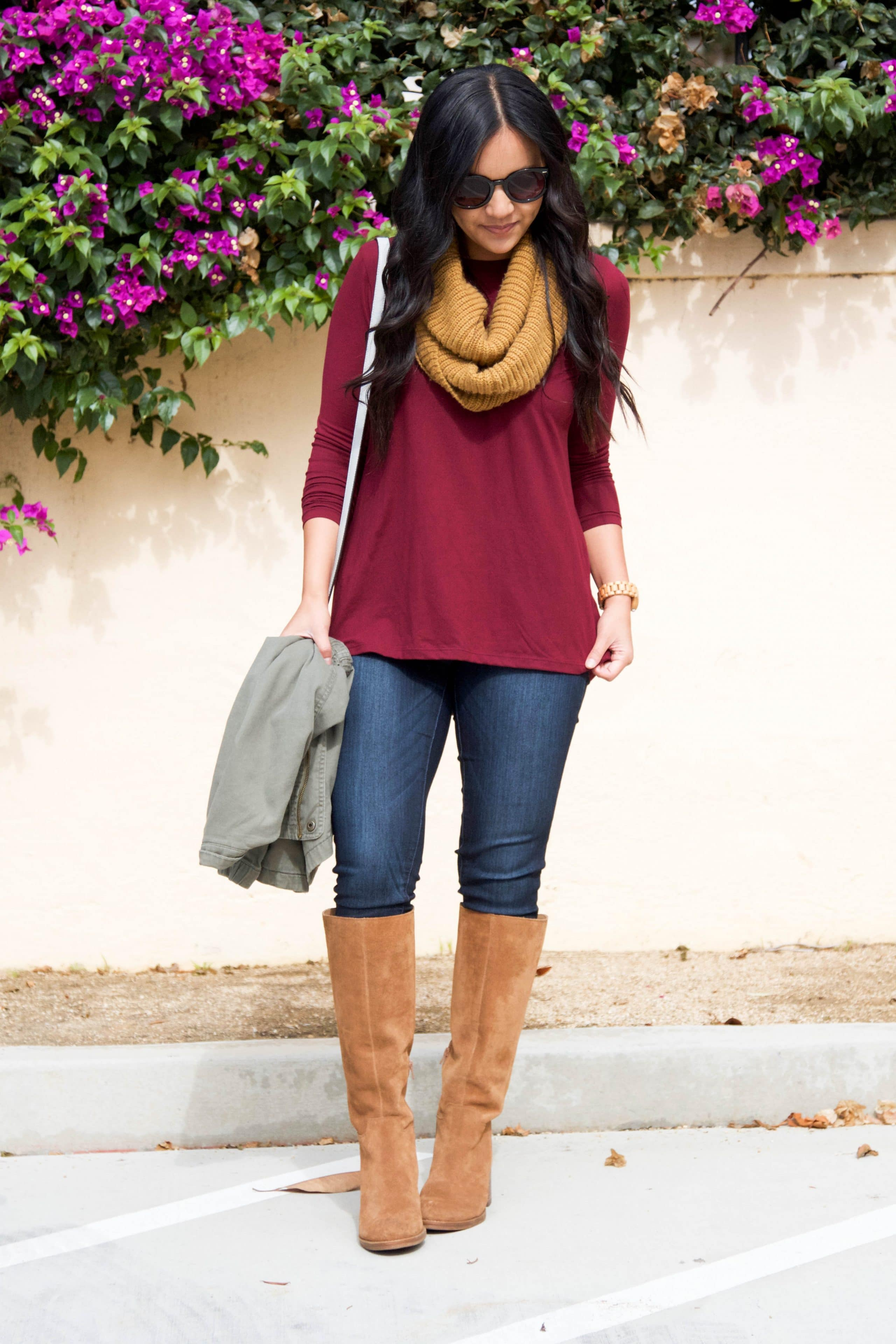 maroon top + jeans + suede boots + mustard scarf