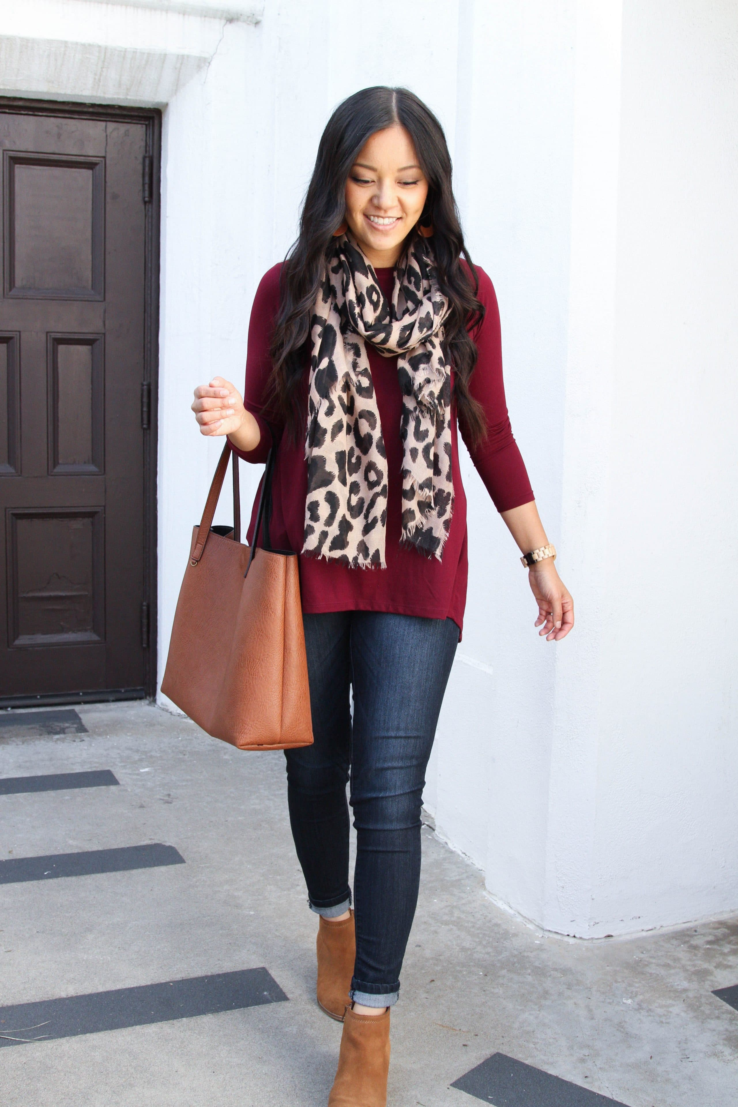 maroon tunic + skinny jeans + leopard scarf + tan booties