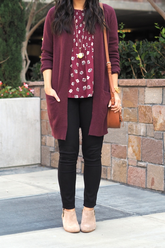 Maroon cardigan + Printed Blouse + Pendant Necklace + Black Jeans + Booties