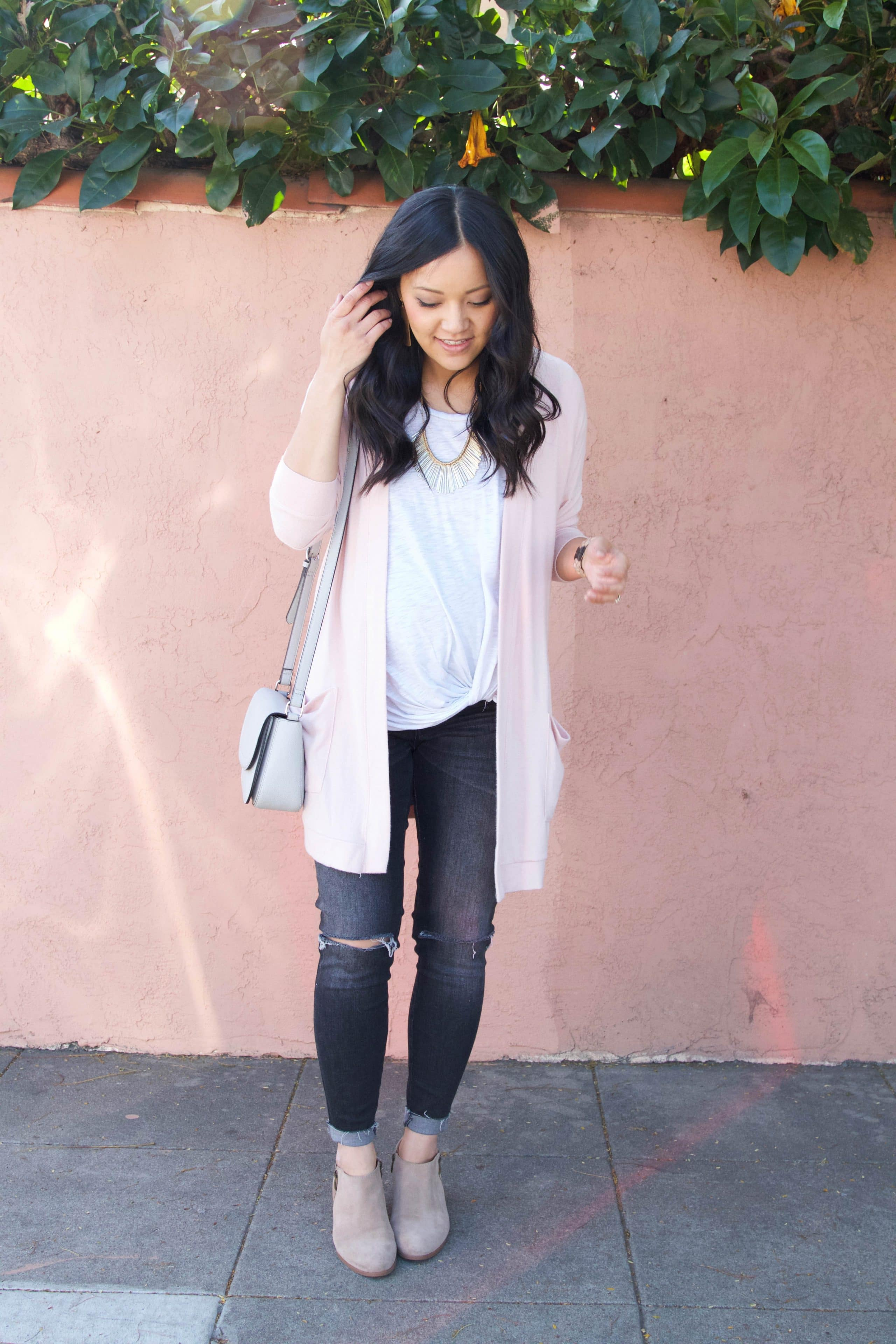 Blush cardigan + twist tee + distressed jeans + booties