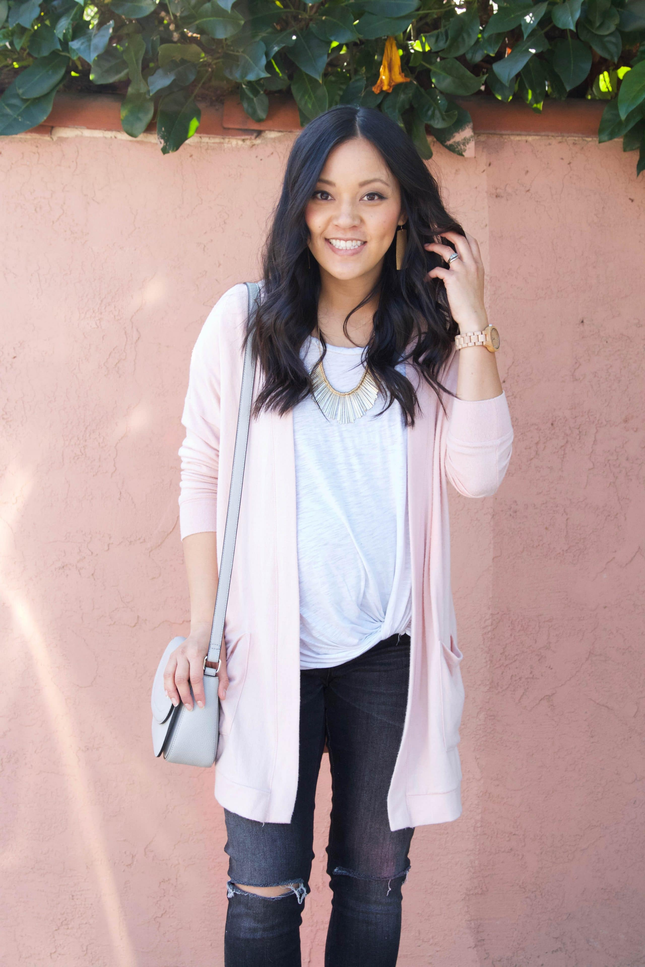 Blush cardi + white twist tee + statement necklace + distressed jeans