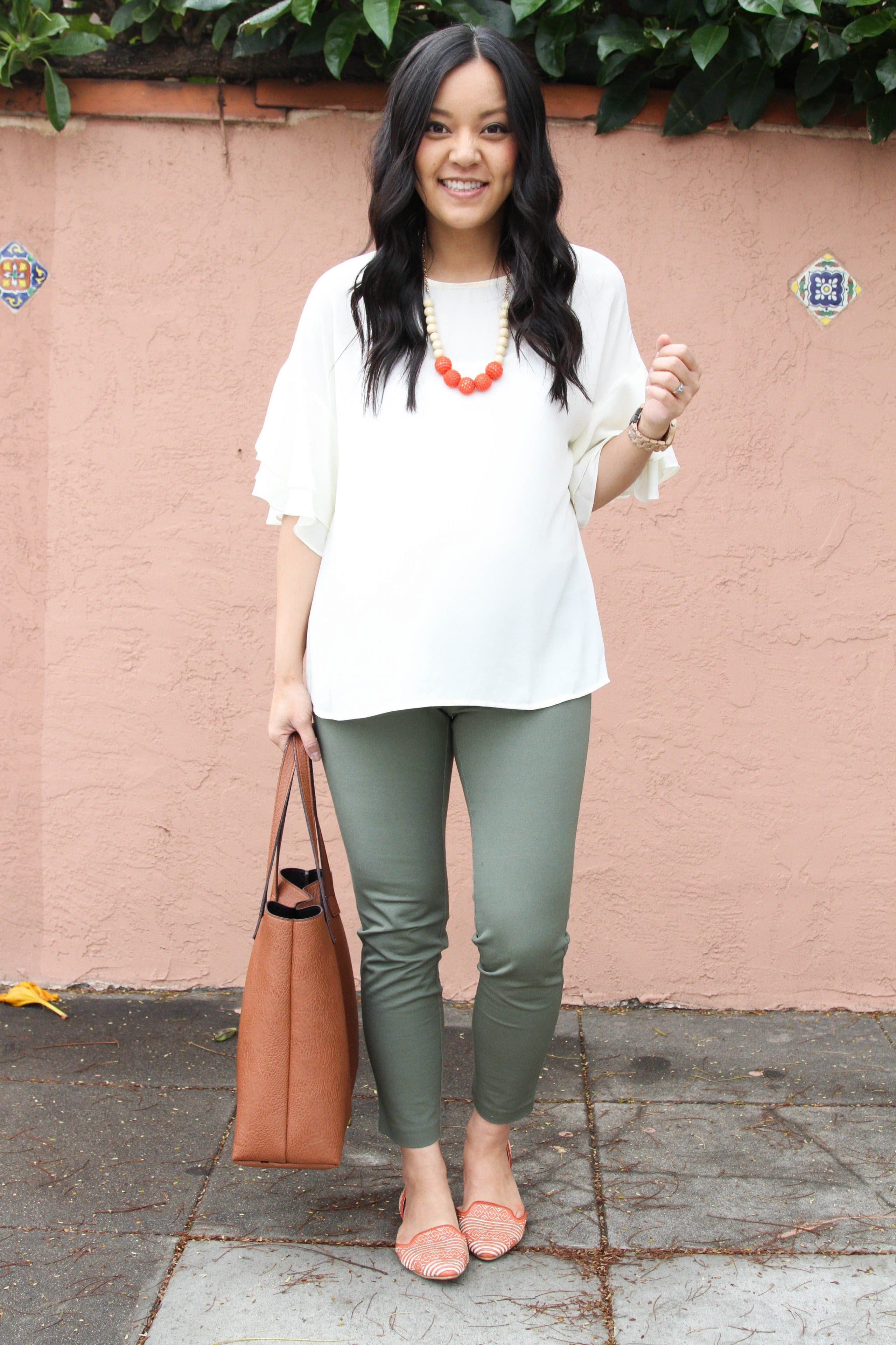 Green Chinos + Cognac Tote + White Bell Sleeves Top + Statements
