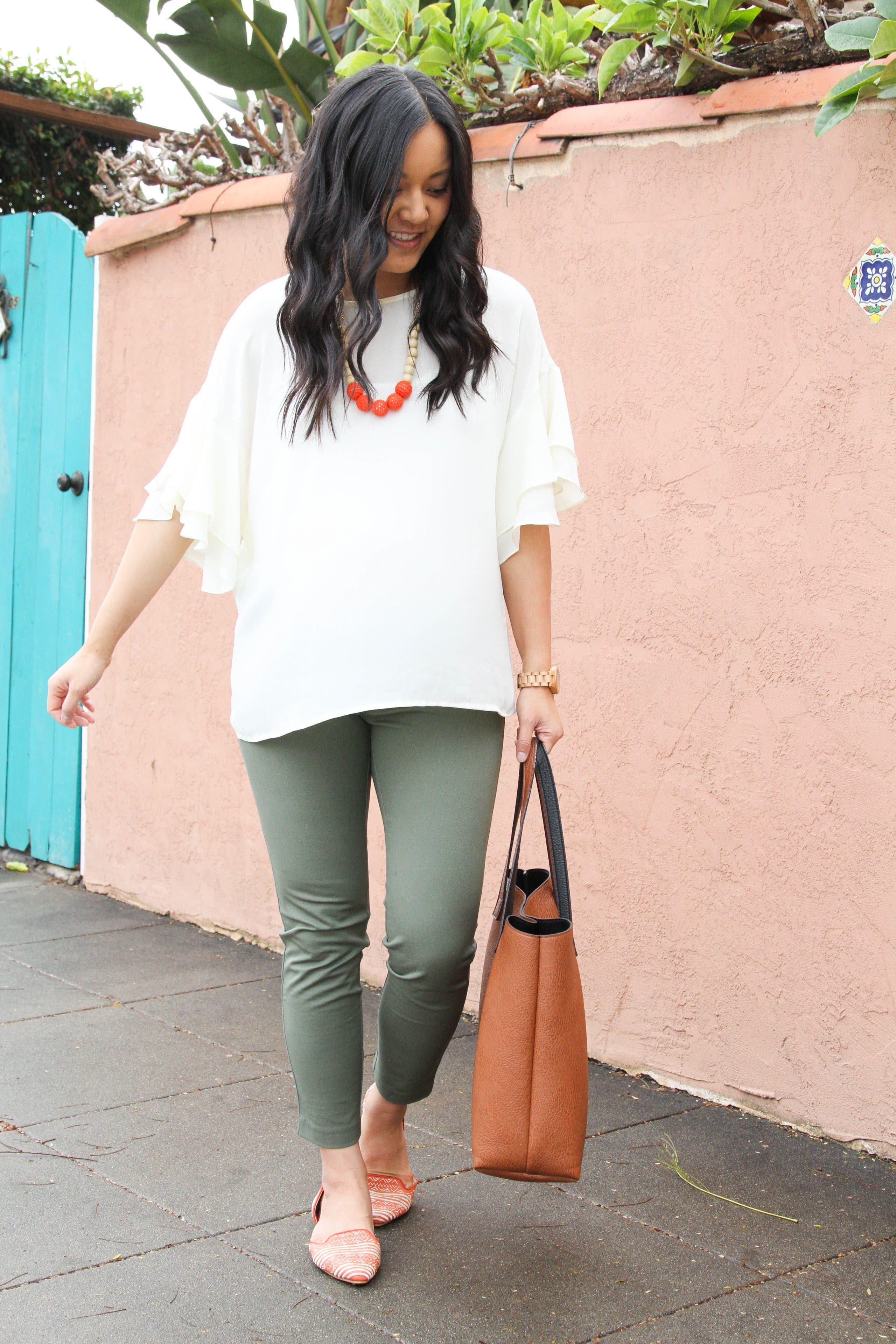 White Bell Sleeve Blouse + Green Chinos + Cognac Tote + Statement Flats