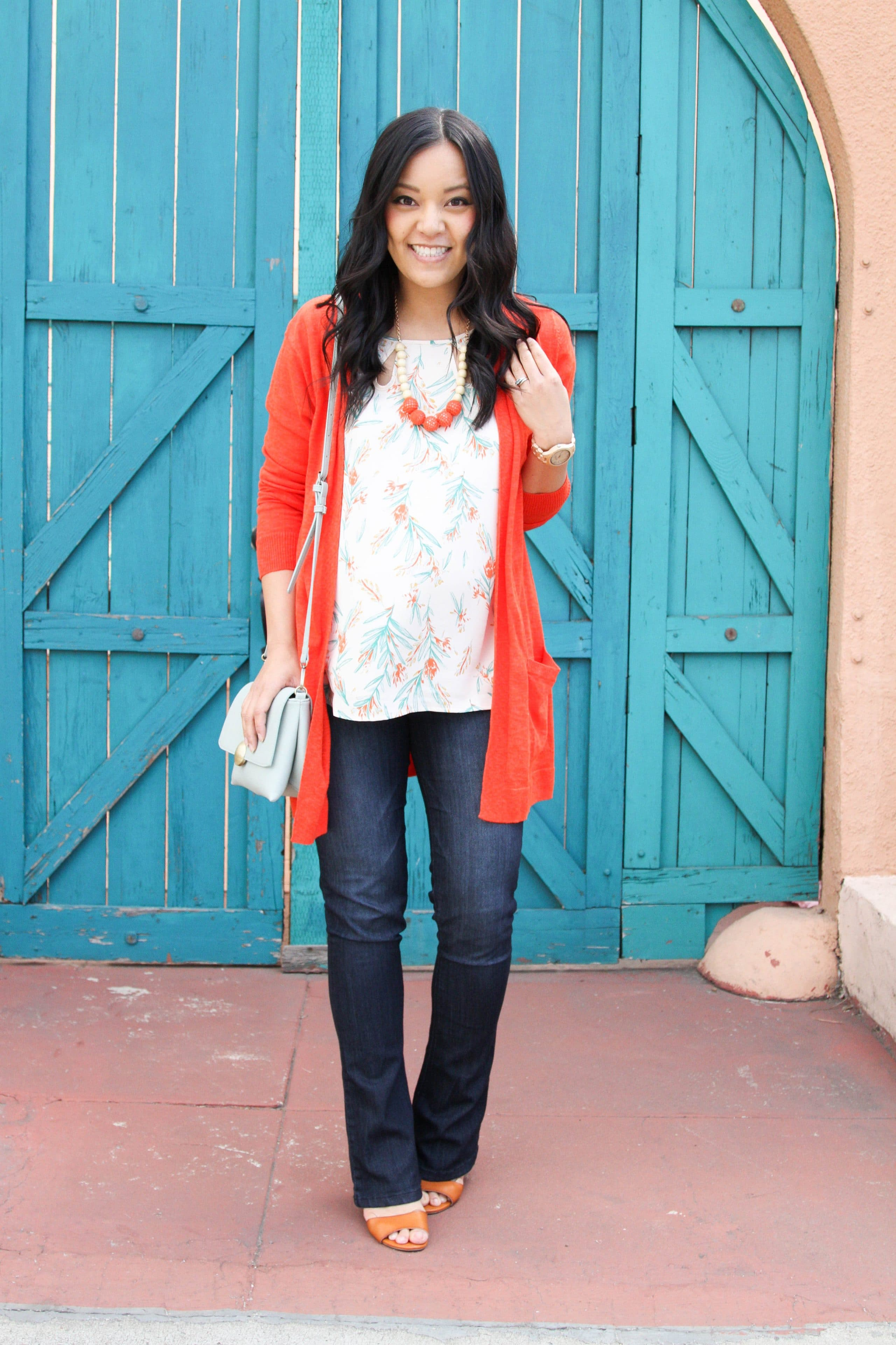 Orange Cardigan + Bootcut Jeans + Floral Top + Statement Necklace
