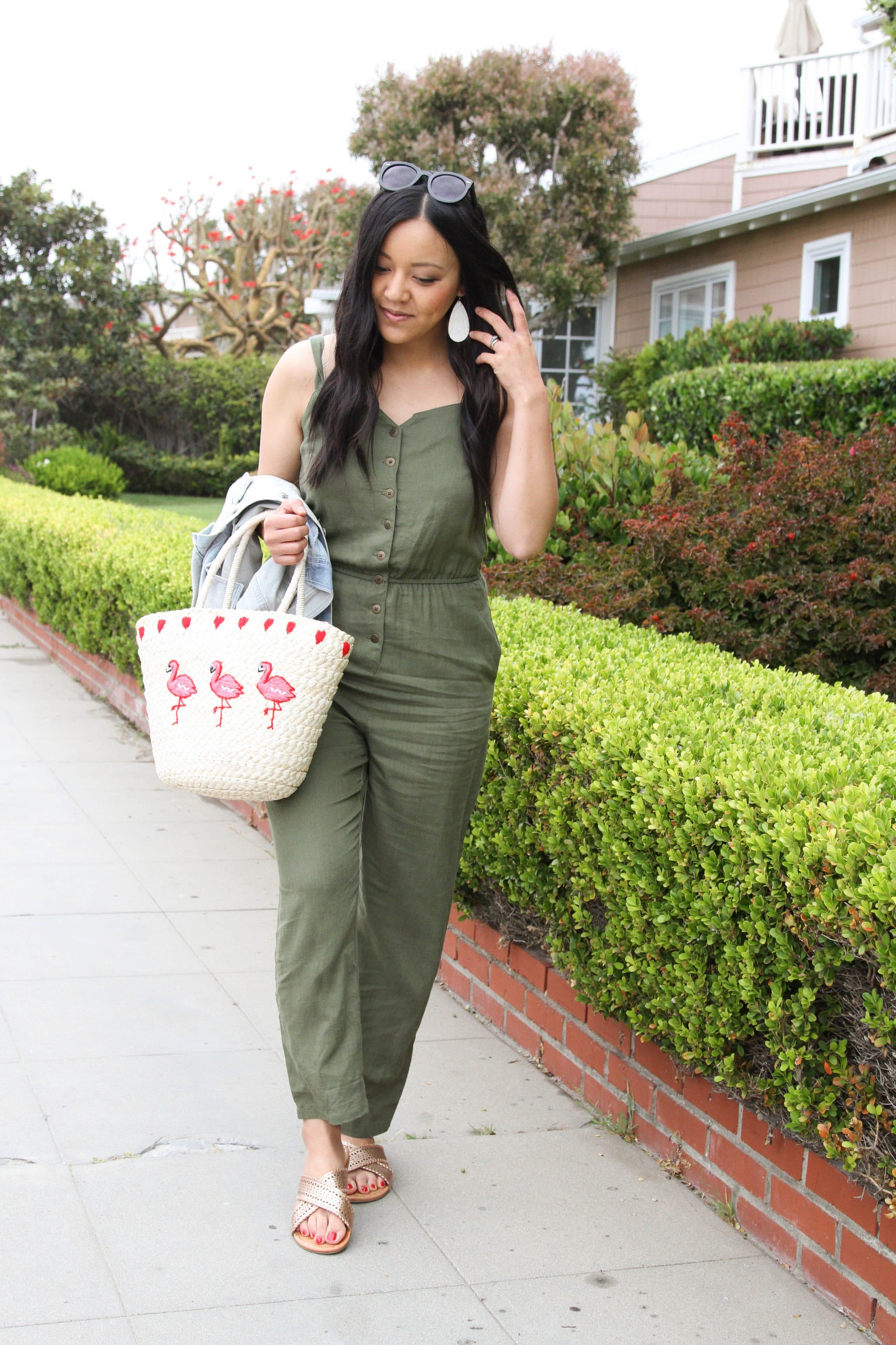59f2c7168d1d3 ... Olive Jumpsuit + Gold Sandals + Straw Tote + Jean Jacket + Statement  Earrings ...