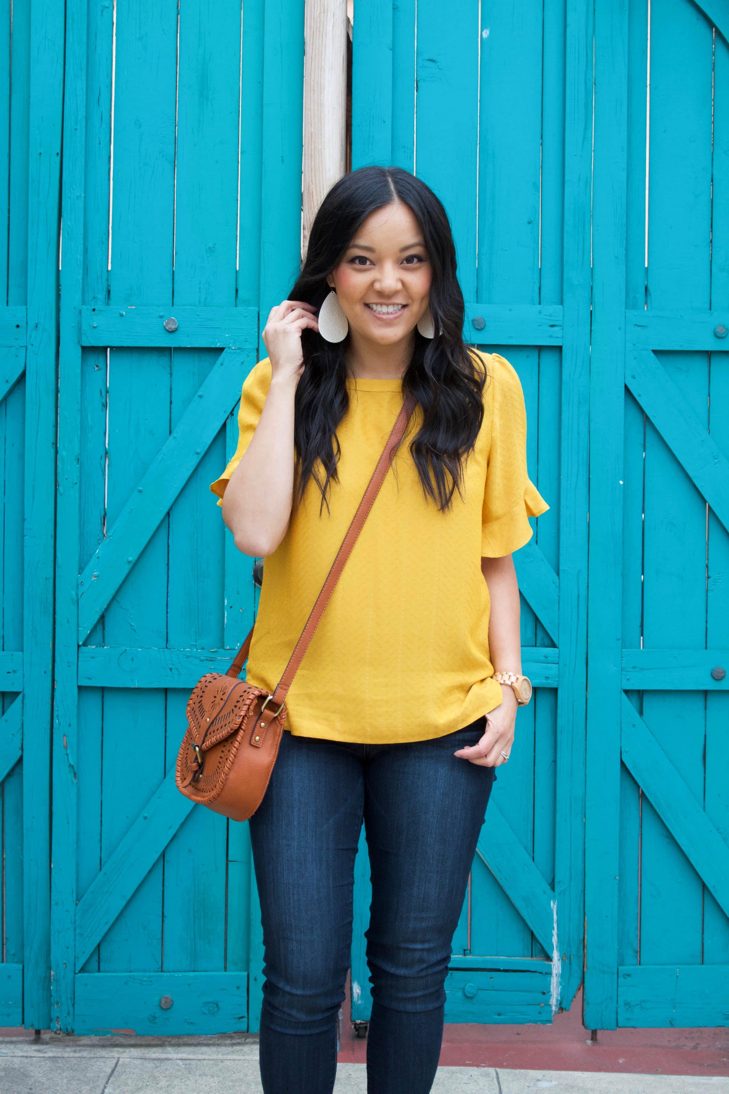 Blue Skinny Jeans + Marigold Top + Cognac Bag + Earrings