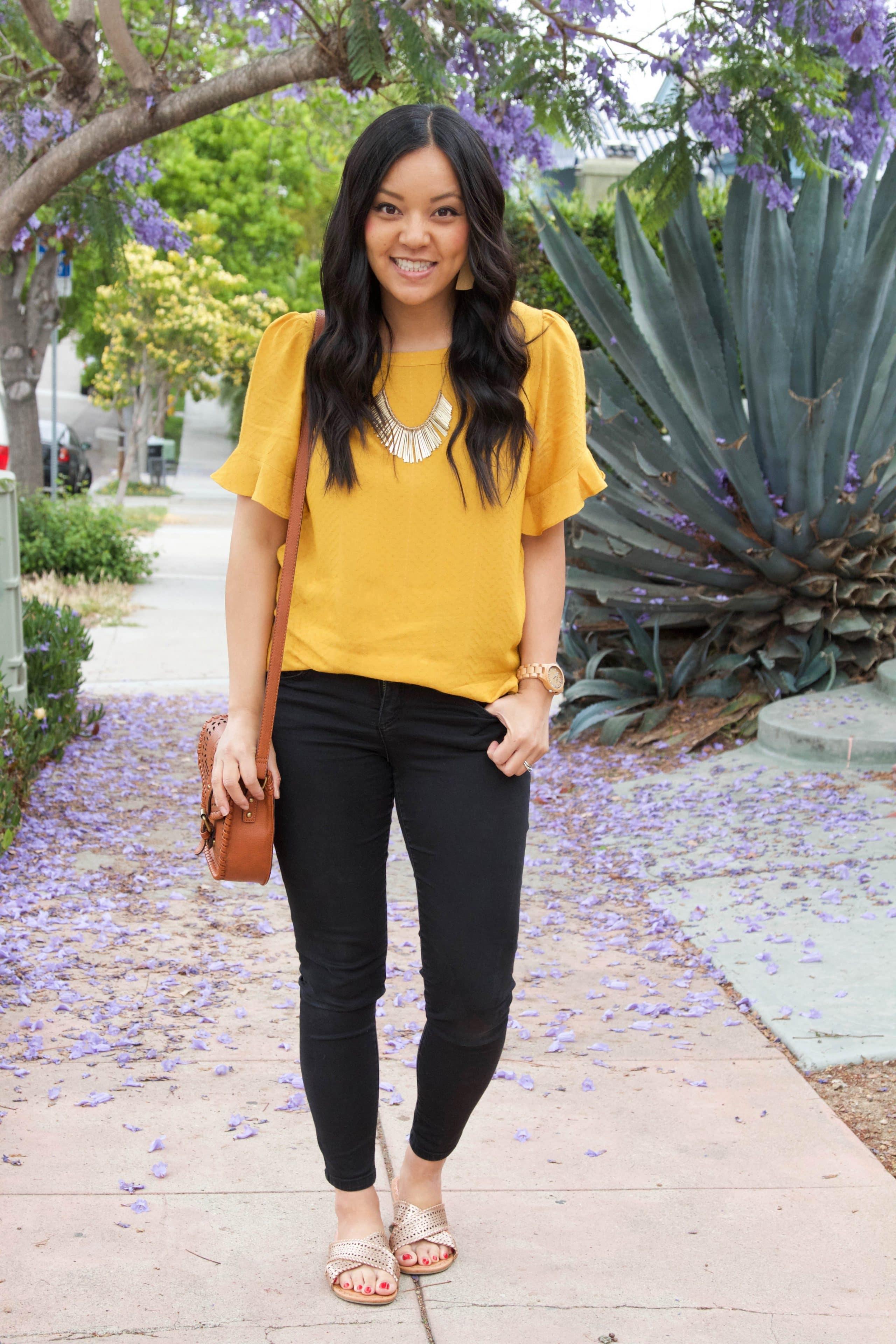 Marigold Blouse + Black Jeans + Gold Sandals + Cognac Bag + Statement Necklace