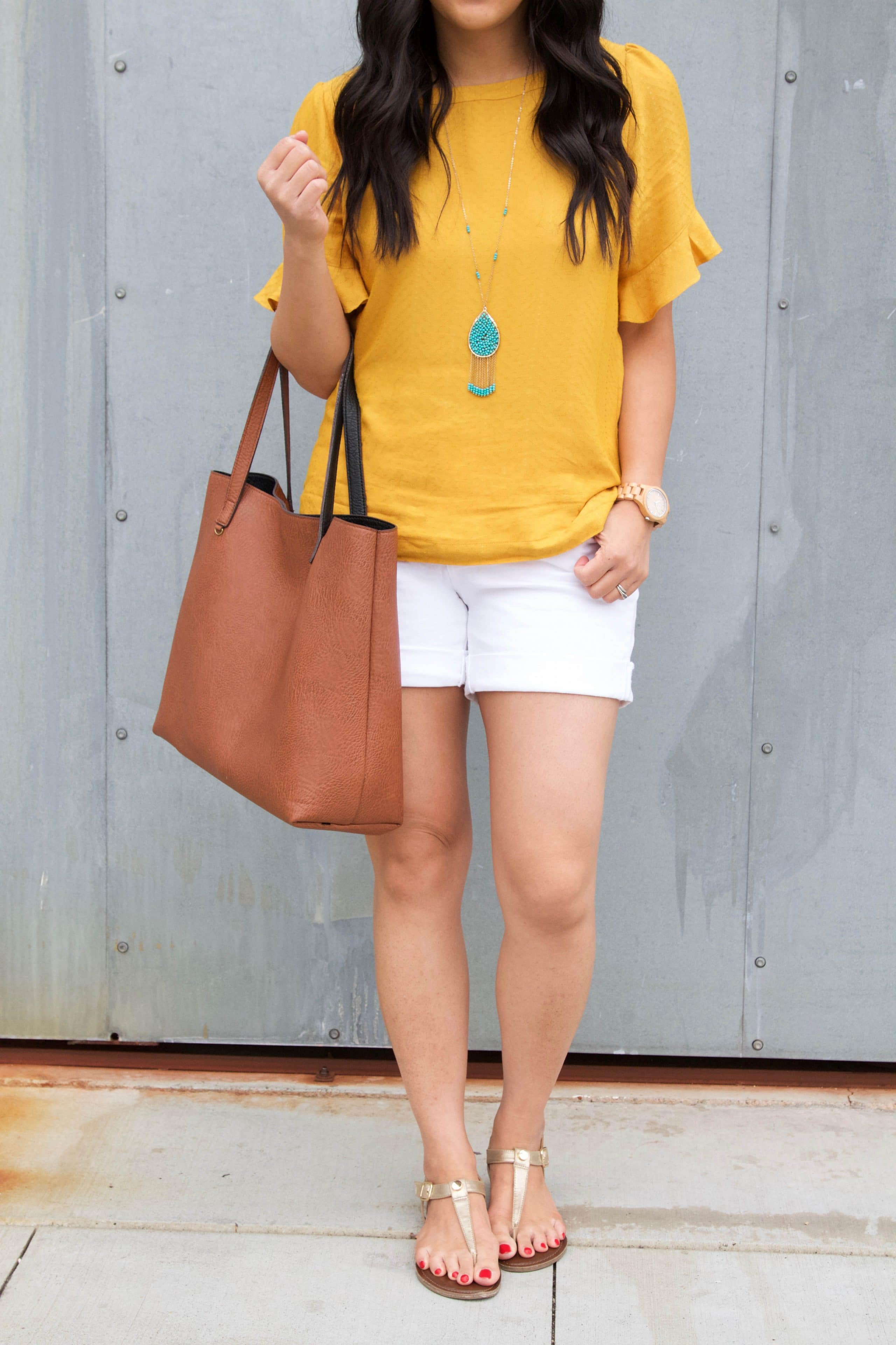 White shorts + Marigold Blouse + Cognac Tote + Turquoise Necklace