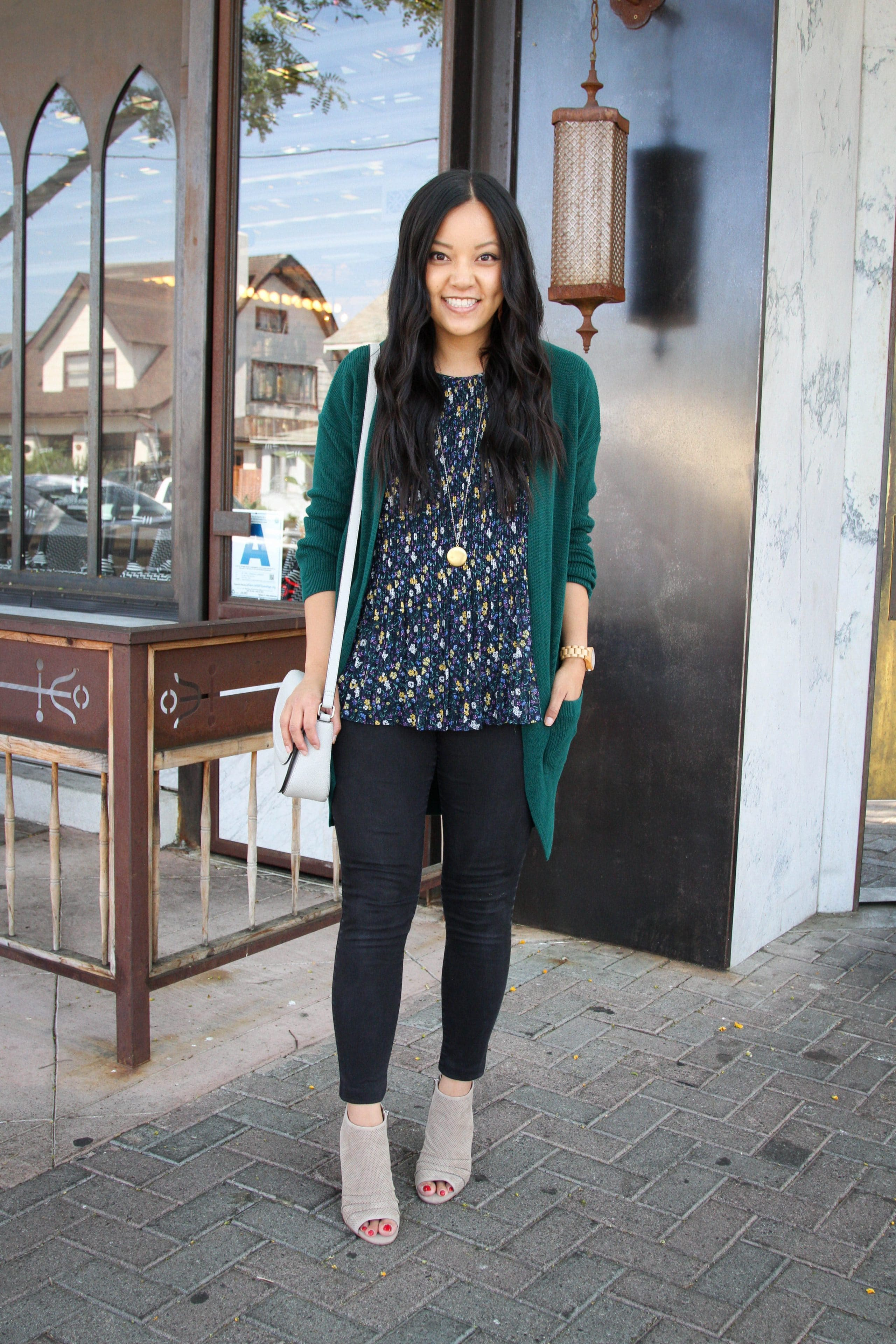 Green Cardigan + Floral Top + Black Jeans + Taupe Booties + Gray Bag