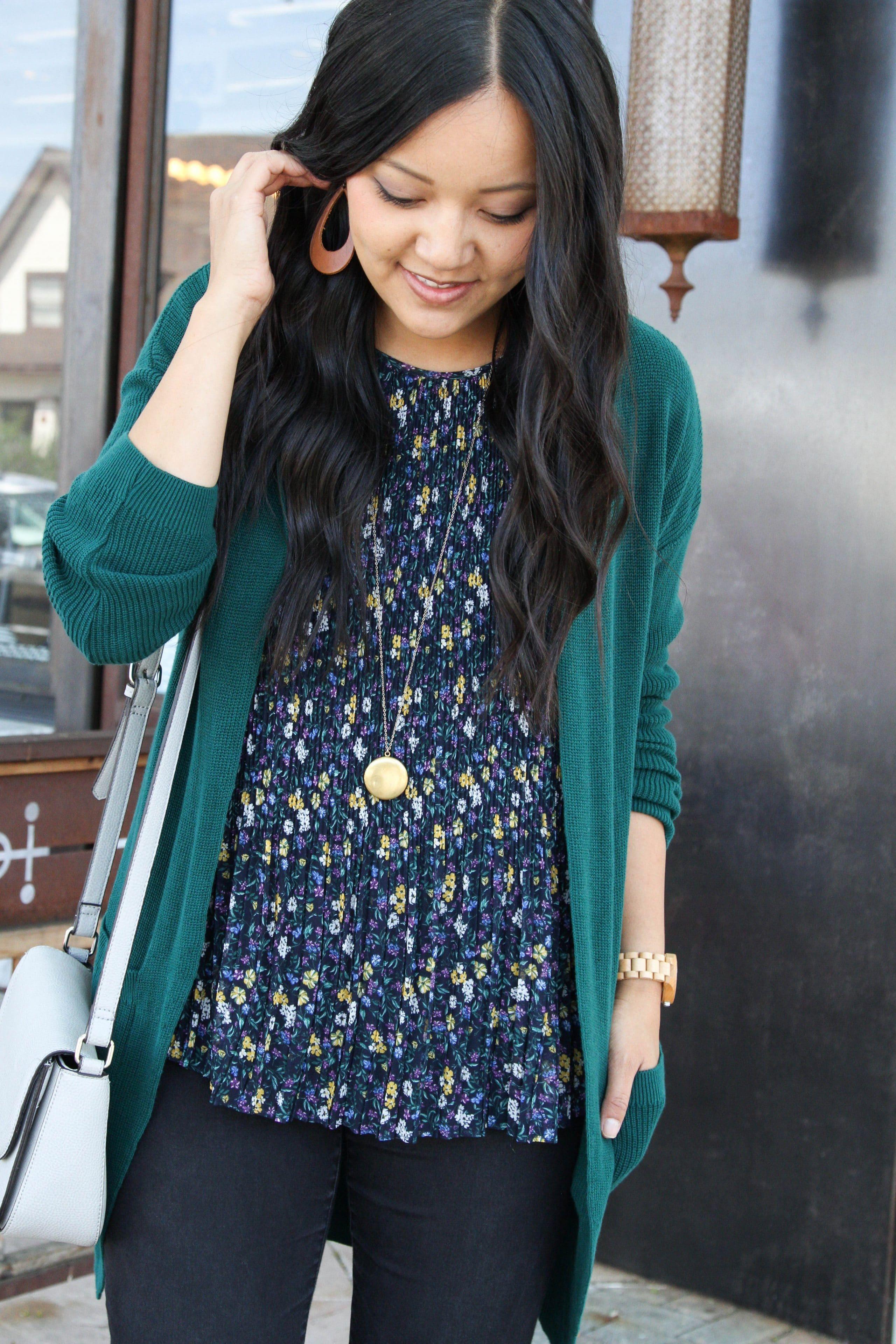Green Cardigan + Cognac Earrings + Floral Top + Black Jeans