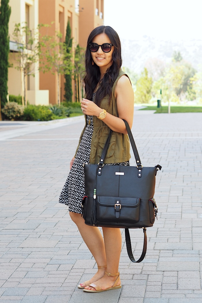 Utility Vest + Black printed dress + sandals + black bag