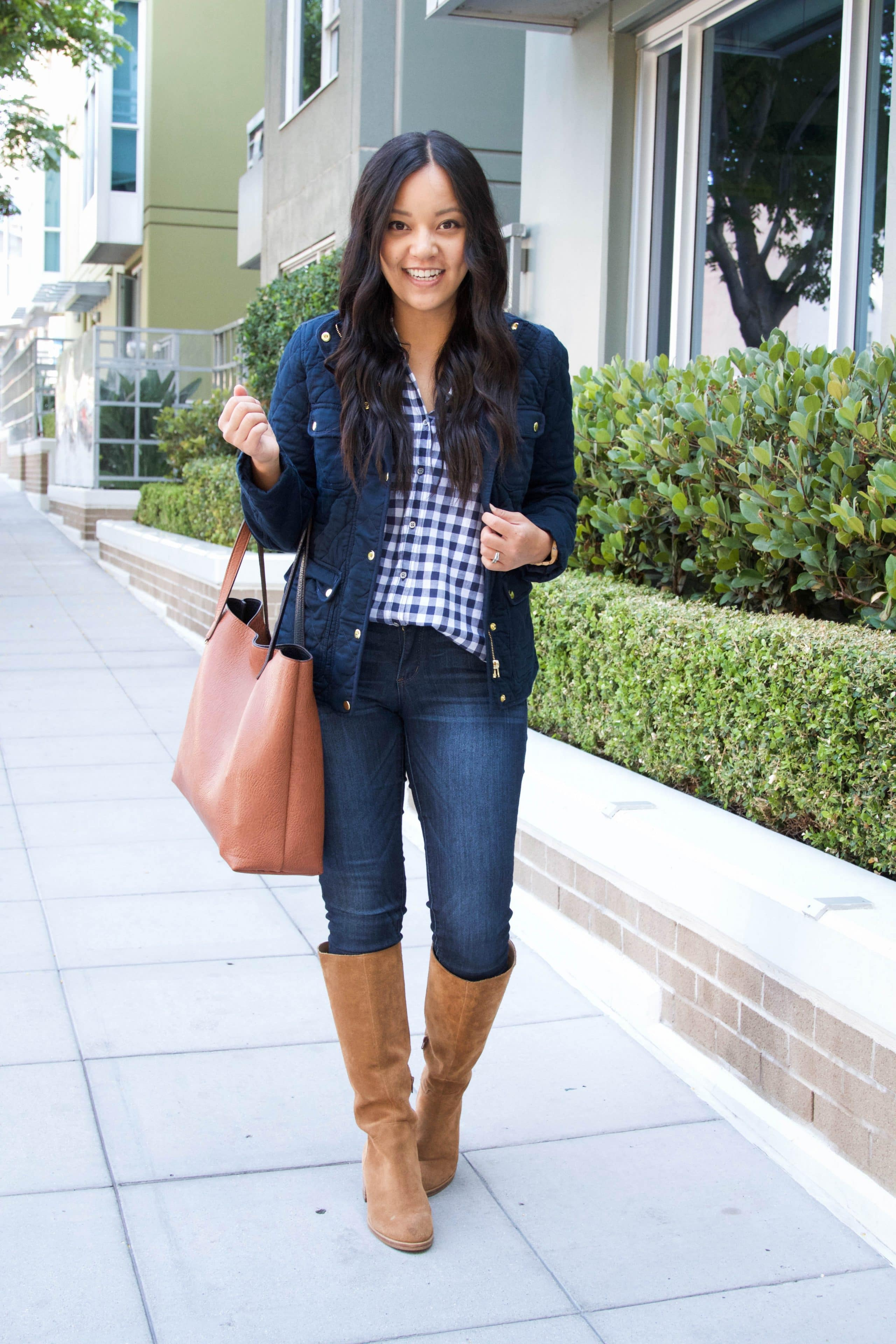 Navy quilted jacket + gingham shirt + tote bag + Riding boots + Skinnies