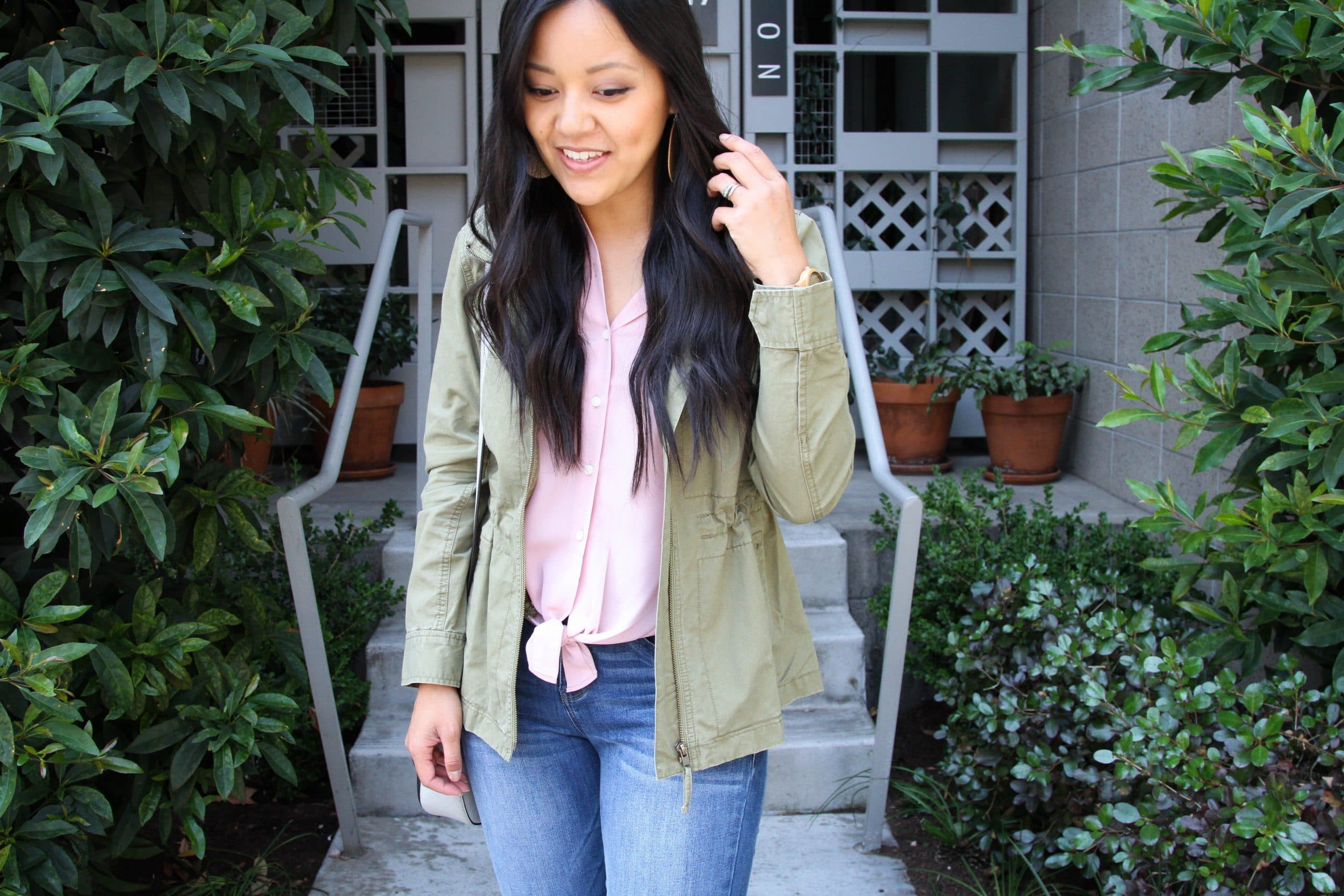Pink top + Utility Jacket + Statement Earrings + Light Jeans