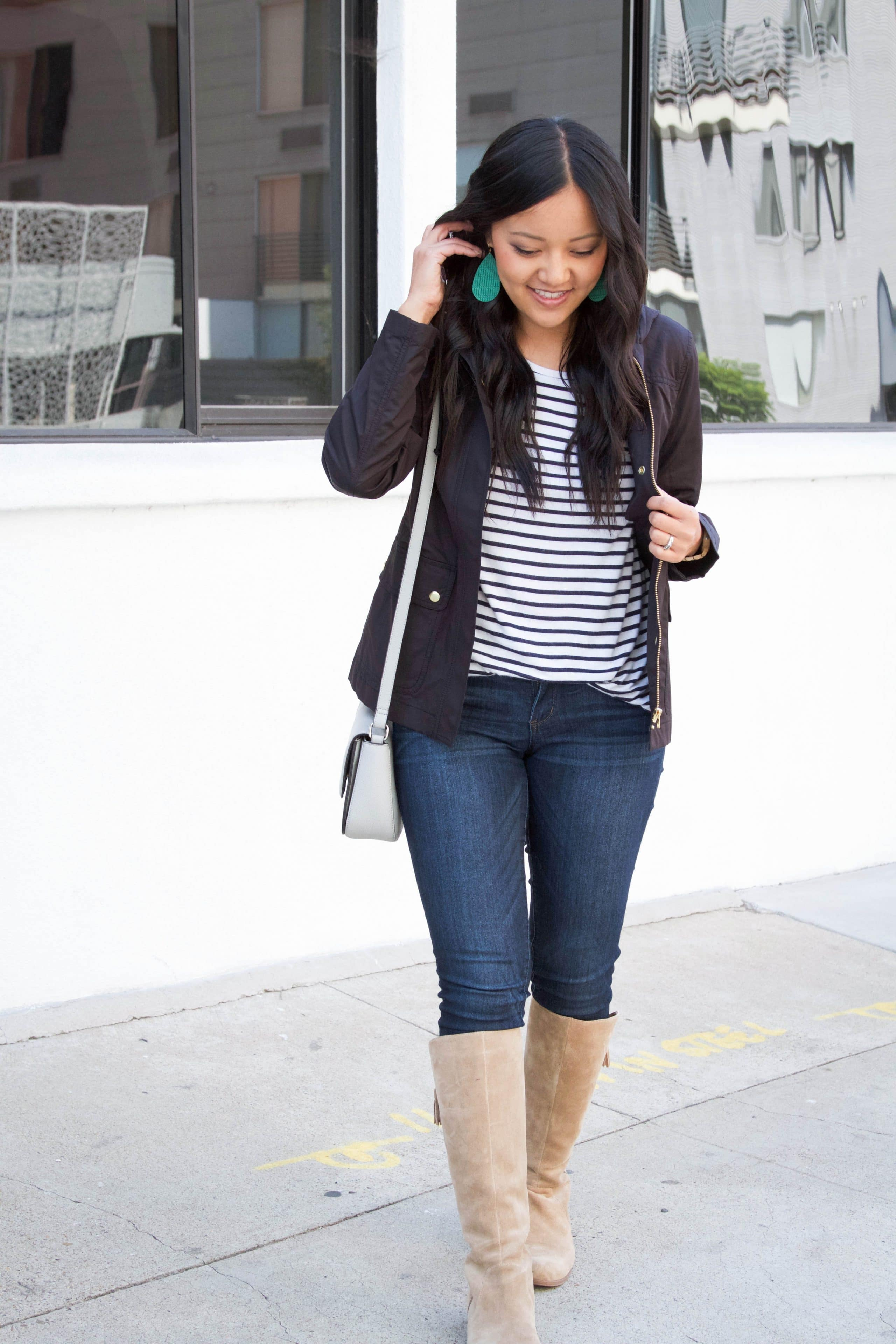 Striped Tee + Black Jacket + Skinnies + Boots + Green Earrings