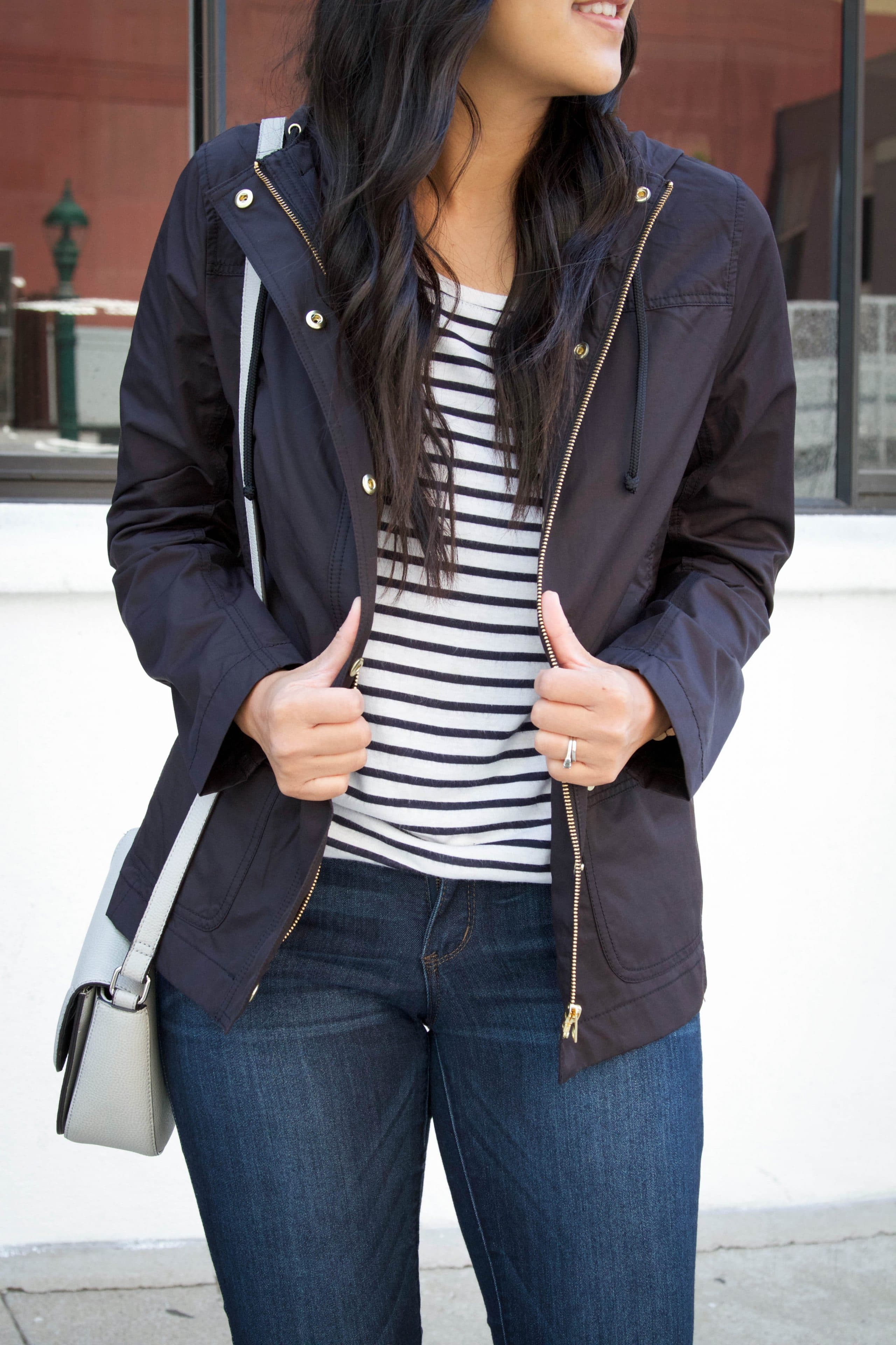 Black Rain Jacket + Striped Tee + Jeans + Grey Bag